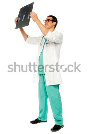 Experienced surgeon looking at patient's x-ray Stock photo © stockyimages