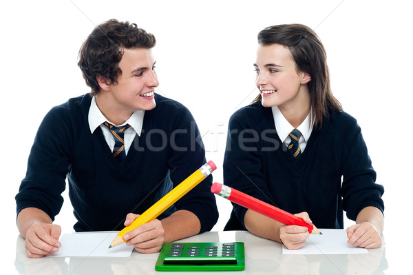 Classmates discussing the correct answer Stock photo © stockyimages