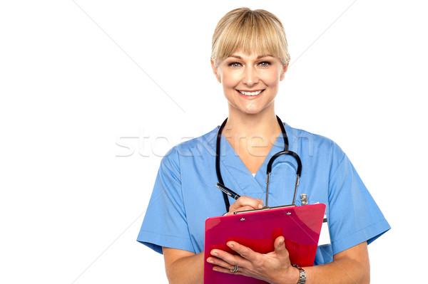 Shot of a cheerful doctor doing her rounds Stock photo © stockyimages