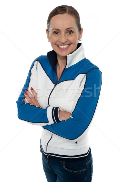 Fashionable middle aged woman striking a stylish pose Stock photo © stockyimages
