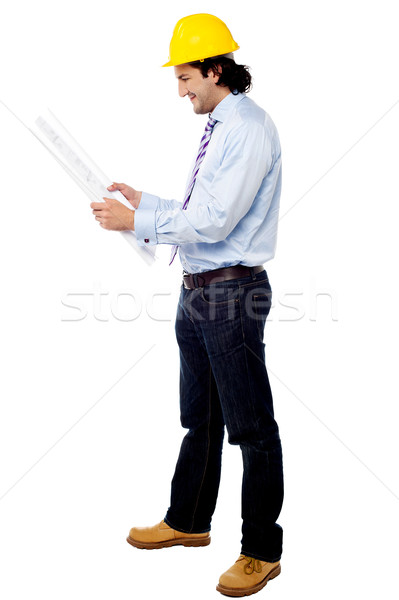 Construction worker reviewing the plan Stock photo © stockyimages