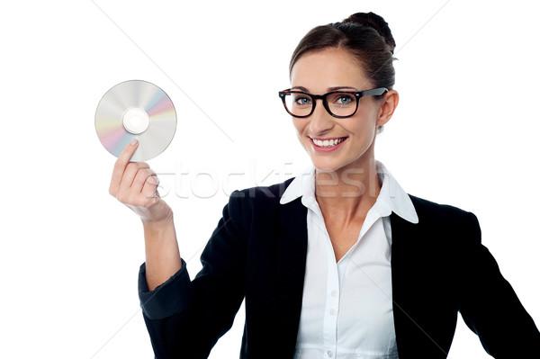деловой женщины компакт-диск улыбаясь корпоративного бизнеса Сток-фото © stockyimages