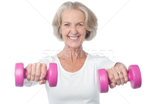 Szczęśliwy kobieta senior wykonywania Zdjęcia stock © stockyimages