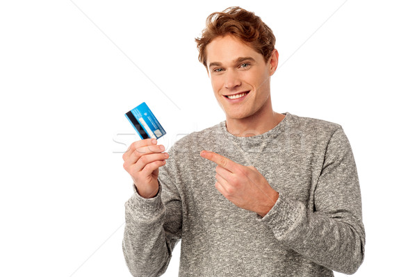 Guy pointing at his credit card Stock photo © stockyimages