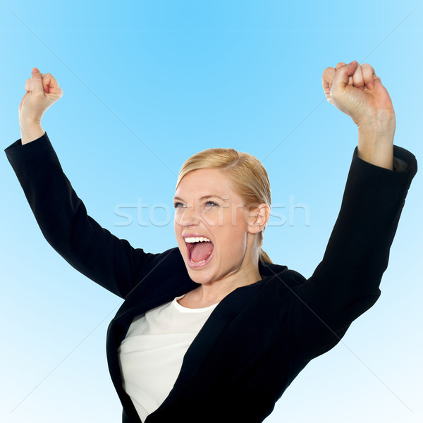 Corporate lady expressing success loudly Stock photo © stockyimages