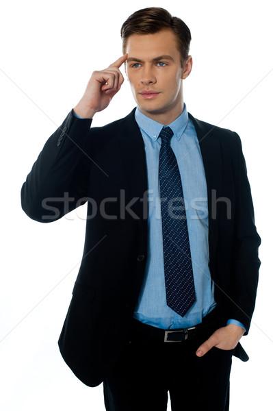 Young buisnessman cracking master idea Stock photo © stockyimages