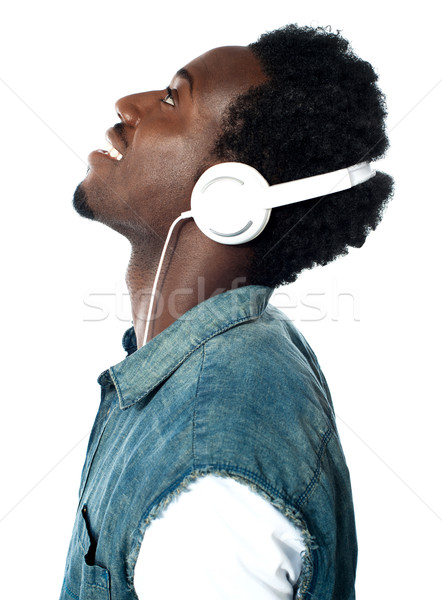 A handsome young boy with headphones Stock photo © stockyimages