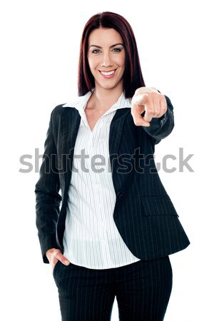 Smiling corporate lady pointing at you Stock photo © stockyimages