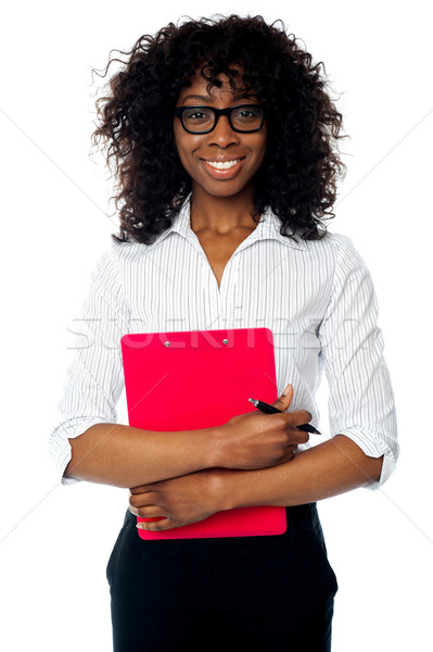 Corporate woman posing with clipboard and pen Stock photo © stockyimages