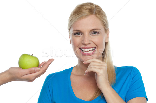 Attractive woman is being offered a green apple Stock photo © stockyimages