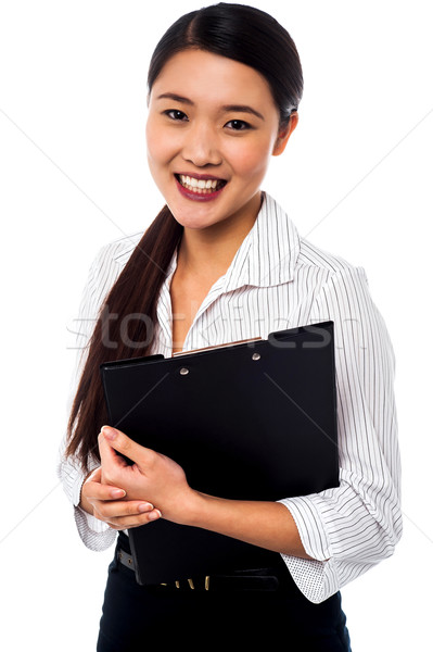 Pretty female executive posing Stock photo © stockyimages