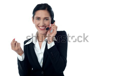 Female customer support executive on call Stock photo © stockyimages
