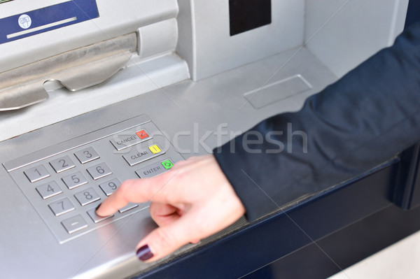Atm pin code vrouw hand machine Stockfoto © stockyimages