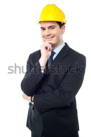 бизнесмен стороны подбородок архитектора улыбаясь бизнеса Сток-фото © stockyimages