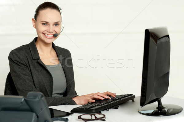 Female employee assisting customers Stock photo © stockyimages