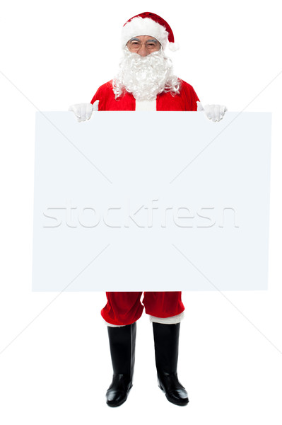 Saint Nicholas standing behind blank whiteboard Stock photo © stockyimages