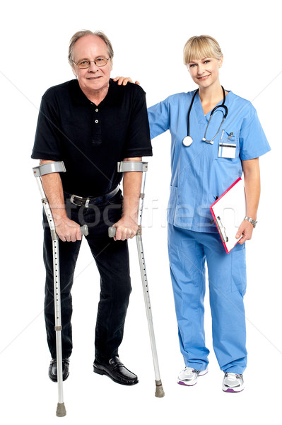 Stock photo: Physician supporting her courageous patient