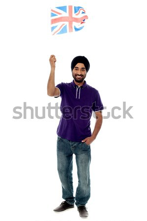Causal guy waving United Kingdom flag Stock photo © stockyimages