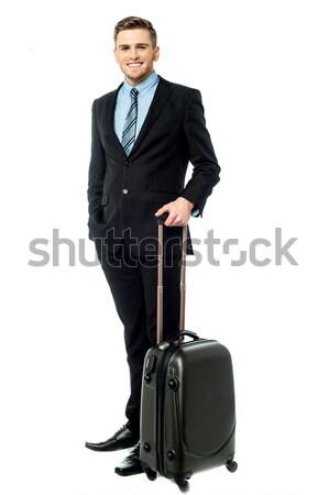 Adam tüm ayarlamak iş gezisi işadamı Stok fotoğraf © stockyimages