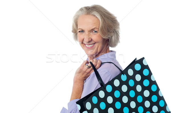 Stock Photo Fashionable Old Lady With Ping Bag Stylish Woman Holding Polka