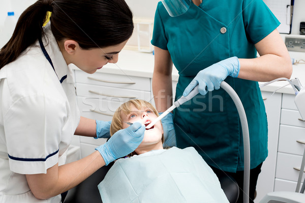 Female dentist treat child patient Stock photo © stockyimages