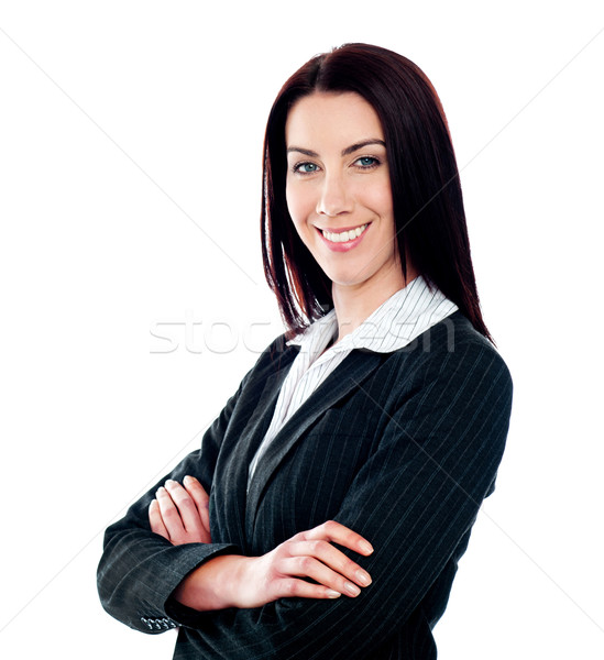 Businesswoman posing with crossed arms Stock photo © stockyimages