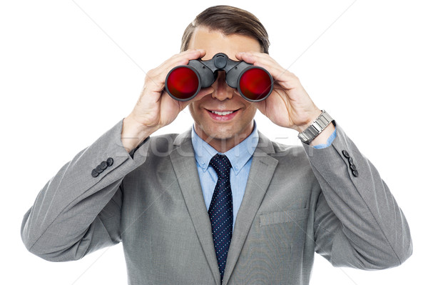 Young officer looking through binoculars Stock photo © stockyimages