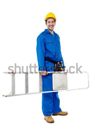 Young repairman ready with stepladder Stock photo © stockyimages