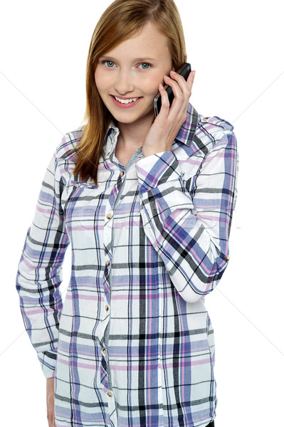 Teenage girl engaged in a conversation Stock photo © stockyimages