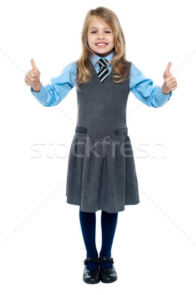 Csinos iskola gyermek mutat remek kézmozdulat Stock fotó © stockyimages