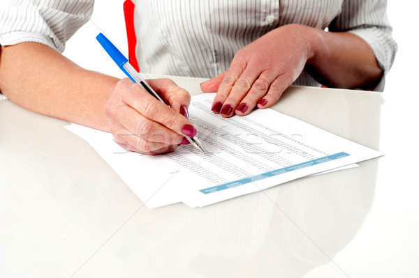 Woman reviewing and verifying employee records Stock photo © stockyimages
