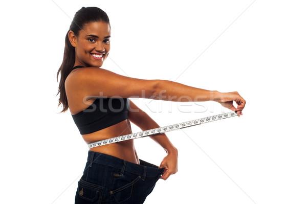 Karcsú nő mér derék fiatal nő fehér Stock fotó © stockyimages