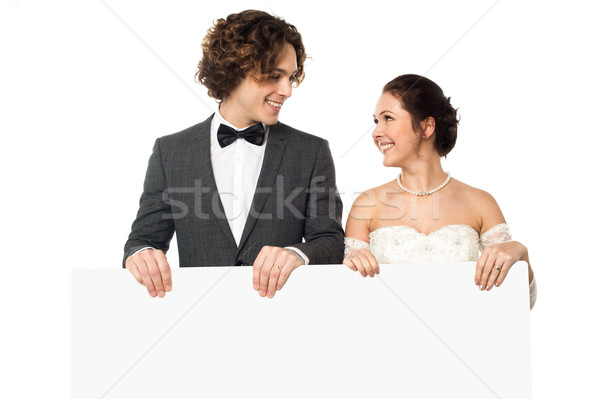 Married couple posing with a blank ad board Stock photo © stockyimages