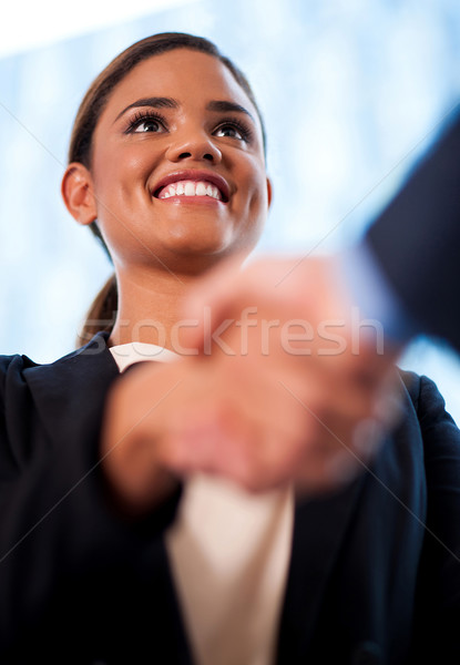 Businesswoman and client handshaking Stock photo © stockyimages