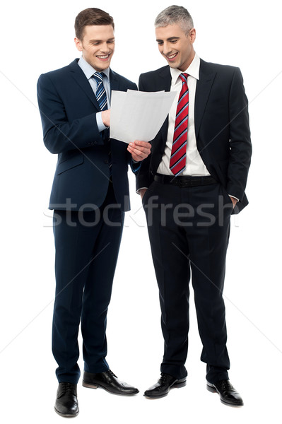 Businessmen evaluating deal documents Stock photo © stockyimages