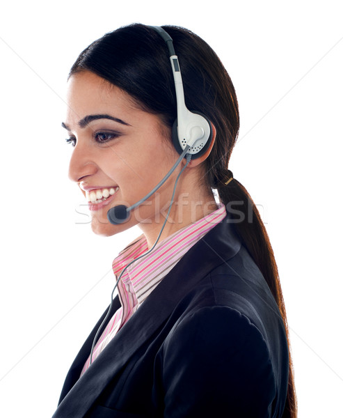 Pretty female customer care executive Stock photo © stockyimages