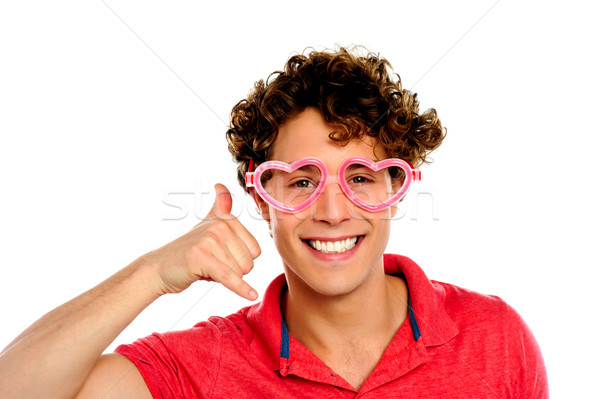 Boy posing with heart shape eye-wear Stock photo © stockyimages