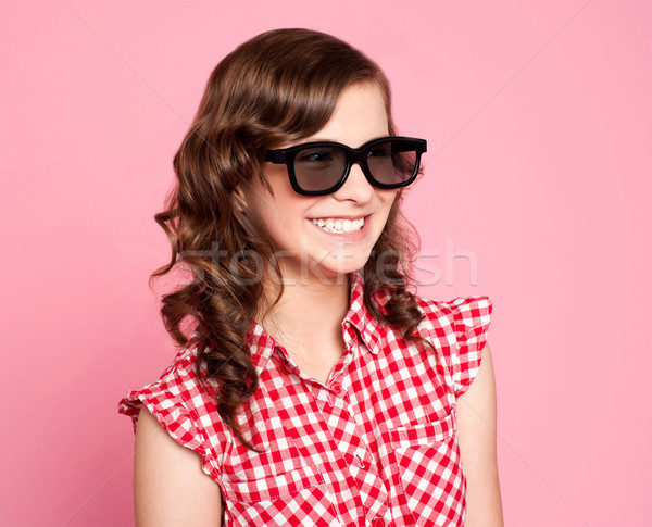 Stock photo: Smiling teenager wearing black goggles