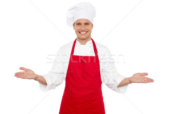 Joyful chef welcoming his guests Stock photo © stockyimages