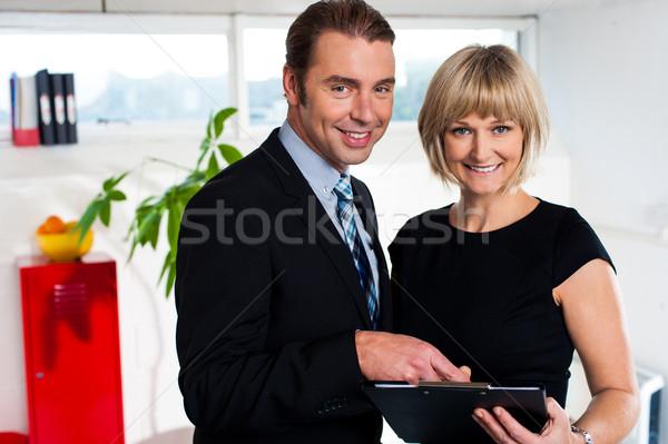 корпоративного пару еженедельно графика женщины секретарь Сток-фото © stockyimages