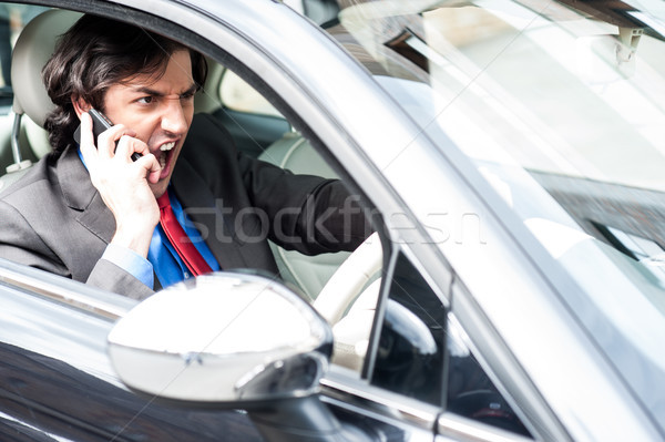 Angry businessman shouting while driving Stock photo © stockyimages