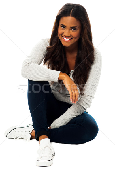 Pretty girl sitting on floor Stock photo © stockyimages