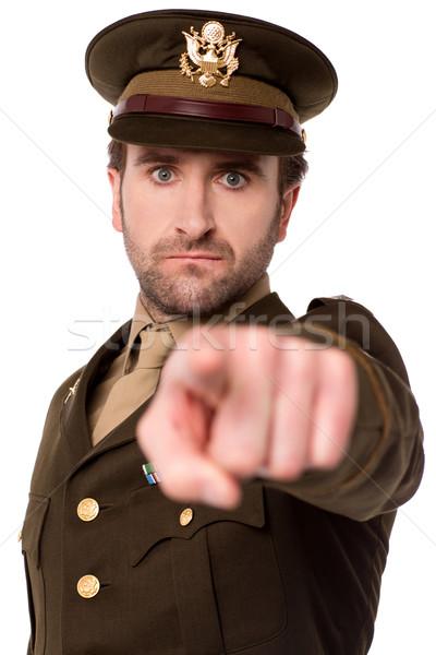 Fiatal katona mutat kamera hadsereg férfi Stock fotó © stockyimages
