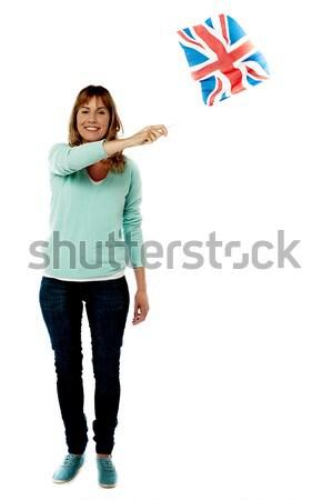 Stock fotó: Fiatal · női · integet · brit · zászló · teljes · alakos · portré