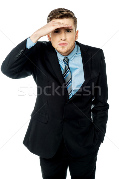 Corporate guy observing something closely Stock photo © stockyimages