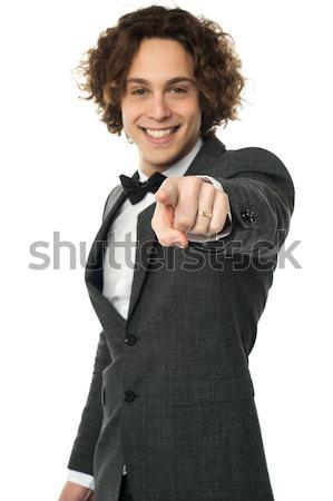 красивый мужчина указывая из молодые парень Сток-фото © stockyimages