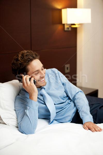 Encantado moço parceiro telefone Foto stock © stockyimages