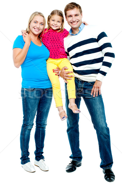 Full length portrait of a cheerful family of three Stock photo © stockyimages