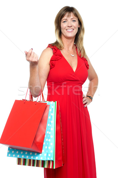 Elegant shopaholic woman carrying shopping bags Stock photo © stockyimages