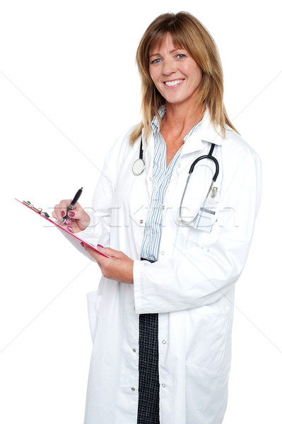 Pleasing doctor collecting patient's health history Stock photo © stockyimages